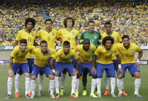 Brazil's national soccer team poses for pictures prior to a friendly soccer match against Panama at the Serra Dourada stadium in Goiania, Brazil, Tuesday, June 3, 2014. Back row, from left: Dante, Fred, David Luiz, goalkeeper Julio Cesar, Luiz Gustavo; first row from left: Oscar, Daniel Alves, Neymar, Ramires, Marcelo, and Hulk. Brazil is preparing for the World Cup soccer tournament that starts on 12 June. Brazil won the match 4-0. (AP Photo/Andre Penner) ORG XMIT: XAP124